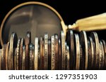 old moneys and coins through a... | Shutterstock . vector #1297351903
