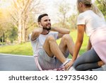 young couple sit up exercising... | Shutterstock . vector #1297354360