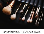 set of make up brushes lies on... | Shutterstock . vector #1297354636