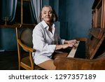 Cute Elderly Woman Playing The...