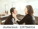 a young woman stroking her... | Shutterstock . vector #1297366516