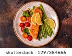 Stock photo grilled salmon with asparagus and tomatoes top view 1297384666