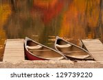 Two Boats Or Canoes Sitting In...