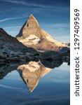 matterhorn and reflection on... | Shutterstock . vector #1297409569
