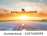 passenger airplane landing at... | Shutterstock . vector #1297420999