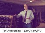 onfident winemaker inviting to ... | Shutterstock . vector #1297459240