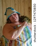 russian woman in a bathhouse...   Shutterstock . vector #1297470850