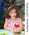 little girl baking christmas...   Shutterstock . vector #1297473916