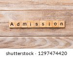 admission word written on wood... | Shutterstock . vector #1297474420