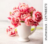 bouquet of spring tulips in... | Shutterstock . vector #1297488373