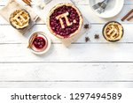 pi day cherry and apple pies  ... | Shutterstock . vector #1297494589