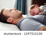 father and baby having... | Shutterstock . vector #1297512130