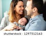 a beautiful couple with newborn ... | Shutterstock . vector #1297512163
