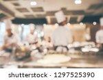 chef cooking in restaurant...   Shutterstock . vector #1297525390