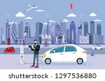 man charging an electric car in ...   Shutterstock .eps vector #1297536880