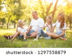 family with children relaxing... | Shutterstock . vector #1297558879