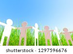 paper people chain in grass ... | Shutterstock . vector #1297596676