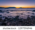 beautiful sea coast sunset... | Shutterstock . vector #1297596946