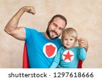 man and child super hero at... | Shutterstock . vector #1297618666