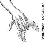female hand holding a bagel.... | Shutterstock . vector #1297661680