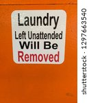 laundry left unattended will be ... | Shutterstock . vector #1297663540