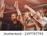 cheerful friends men fans watch ... | Shutterstock . vector #1297707793