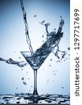 splashing water on blue... | Shutterstock . vector #1297717699