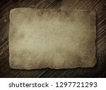 old paper on the wood background   Shutterstock . vector #1297721293