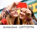 teenage girls on vacation... | Shutterstock . vector #1297725796