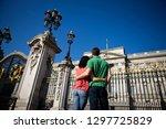 tourist couple on vacation... | Shutterstock . vector #1297725829