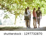 four young friends walking... | Shutterstock . vector #1297732870