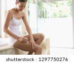 woman in underwear in bathroom... | Shutterstock . vector #1297750276