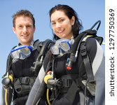 couple on vacation wearing... | Shutterstock . vector #1297750369