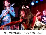 young female singer performing... | Shutterstock . vector #1297757026