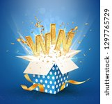 Stock vector win gold text open textured blue box with confetti explosion inside and golden win word flying 1297765729