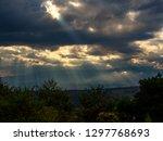 sunbeams casting their light...   Shutterstock . vector #1297768693