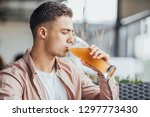 one boy drinking beer and... | Shutterstock . vector #1297773430