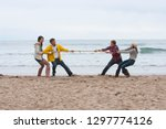 young couples playing tug of... | Shutterstock . vector #1297774126