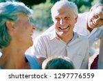 smiling senior couple smiling... | Shutterstock . vector #1297776559