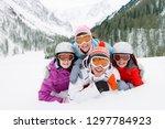 family in goggles on winter ski ... | Shutterstock . vector #1297784923