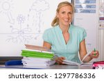 female school teacher marking... | Shutterstock . vector #1297786336