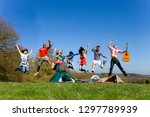 group of young friends on... | Shutterstock . vector #1297789939
