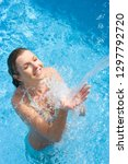 smiling woman in bikini in... | Shutterstock . vector #1297792720