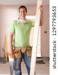 smiling male carpenter holding... | Shutterstock . vector #1297793653