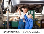 son helping father mechanic to... | Shutterstock . vector #1297798663