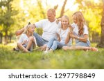 family with children relaxing... | Shutterstock . vector #1297798849