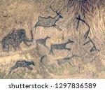 primitive art painted on rock... | Shutterstock . vector #1297836589