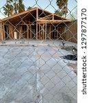 house under repair behind chain ... | Shutterstock . vector #1297877170