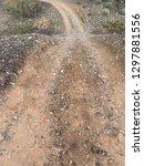 dirt road in desert with large... | Shutterstock . vector #1297881556