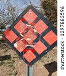 tattered caution sign in desert | Shutterstock . vector #1297883596